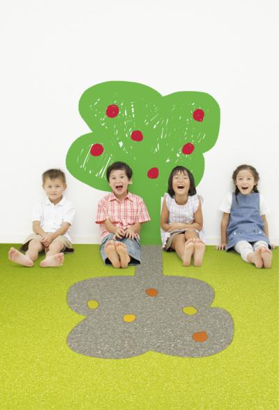 Children sitting on floor, smiling
